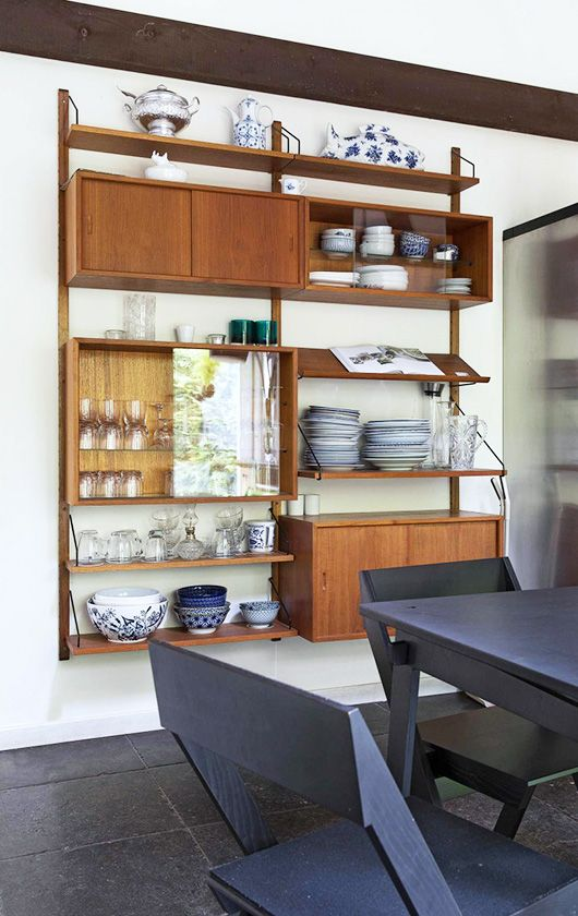 dining space with built-in wood shelving unit. / sfgirlbybay