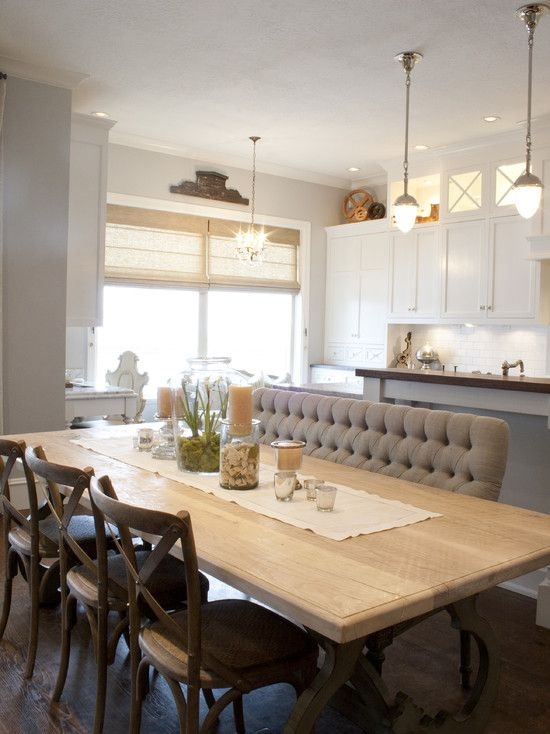 love the wonderful mix of dining room chairs, banquette and bench