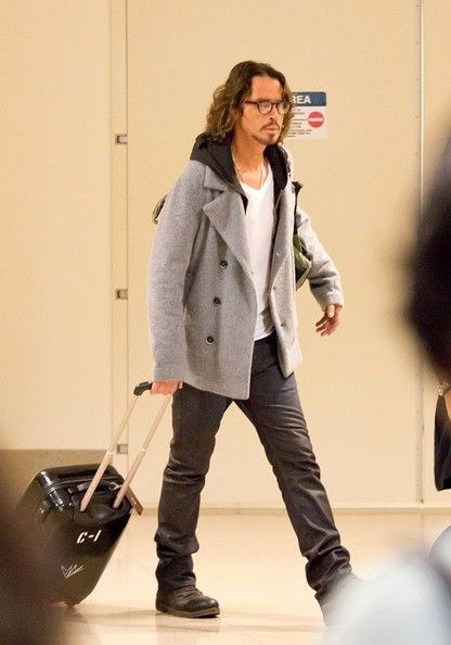 Chris Cornell and his wife Vicky Karayiannis arrive at LAX (Los Angeles International Airport). Description from zimbio.com. I searched for this on bing.com/images