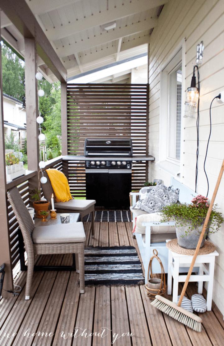 Porche de estilo n rdico con barbacoa terrazas - Como decorar un porche abierto ...