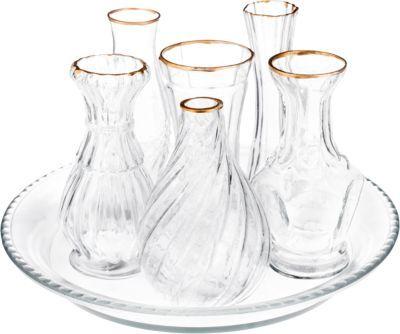 """#Unisex #Glas #Vasen #Set #Toledo #7 #teilig #farblos Das 7-teilige Glas Vasenensemble-Set """"TOLEDO´´ besteht aus einer flachen Glasschale und sechs unterschiedlichen Glasvasen. Mit diesem dekorativen Set können Sie immer wieder neue Arrangements gestalten. - Durchmesser der Glasschale: ø 23 cm - Höhe der Vasen: 14 cm Material: Glas"""