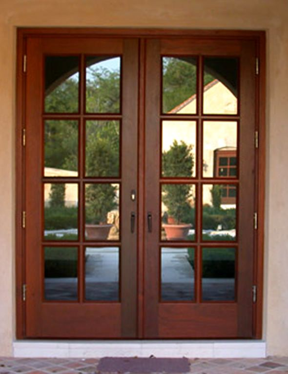 Front doors for homes with glass wood french doors for Wood exterior front doors