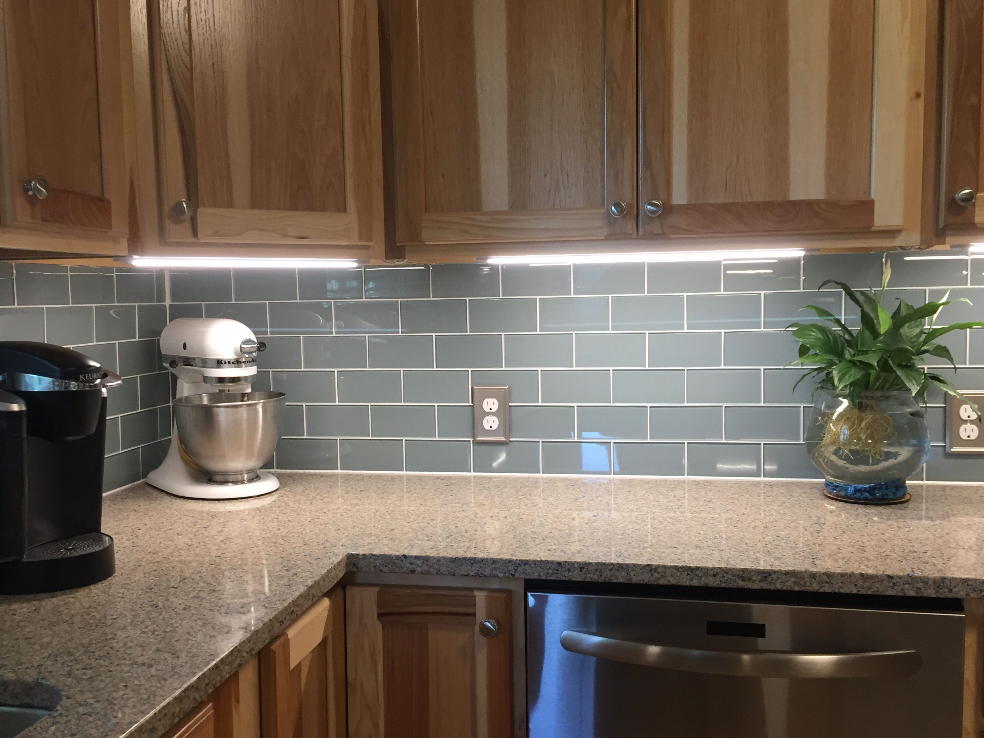 Smoky Blue Glass Tile Backsplash And Under Cabinet Lighting Light Kitchen Cabinets Blue Glass Tile Backsplash Glass Tile Backsplash