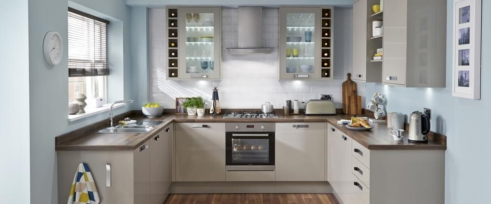 The Greenwich Gloss Stone Kitchen Features Gloss Stone Slab Doors,  Complement With Chrome Effect Slope Handles For A Contemporary Look.