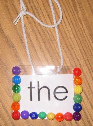 Use a plastic name badge and glue beads or jewels around the