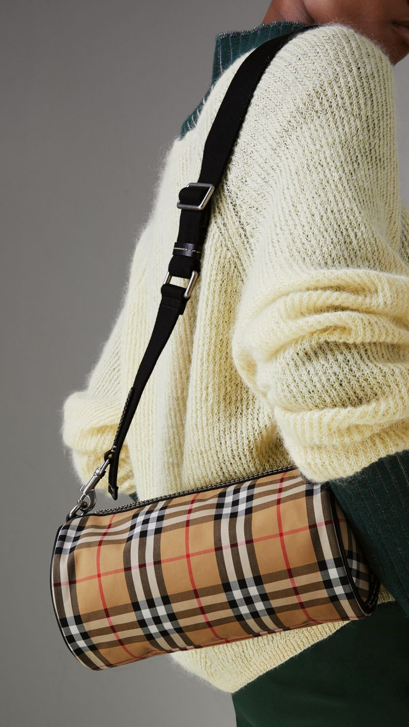 211fc7a813b5 A cylindrical bag in our archive-inspired Vintage check with topstitched  leather trims.