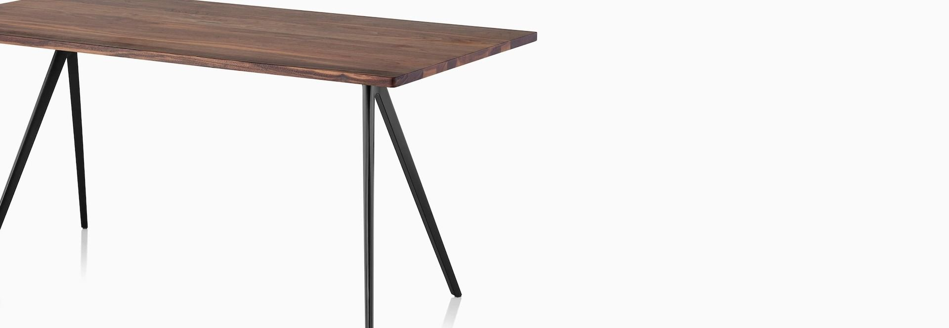 A Magis Baguette Table With A Medium Veneer Top And Black Legs