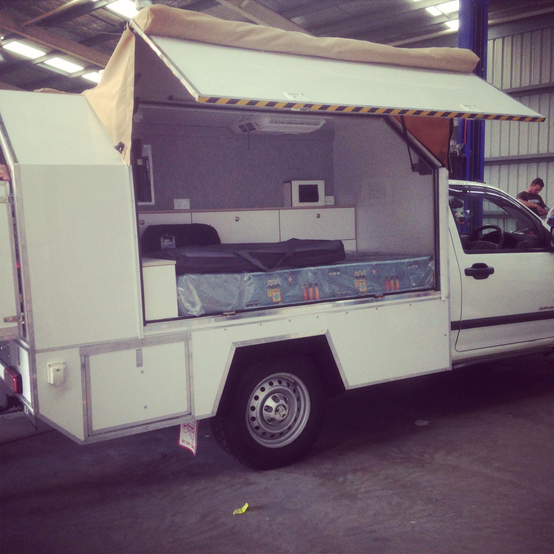 Custom built slide on camper by Red Dog Campervans. The
