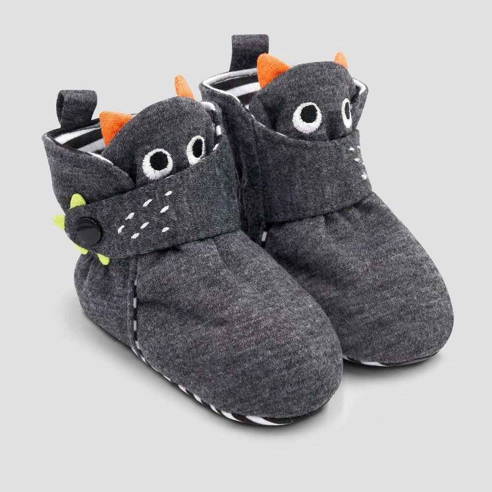 393da7fbd80 Keep your little one looking adorable with these Baby Monster Bootie  Slippers with Snap by Cat and Jack. Made with soft and breathable polyester  these tiny ...