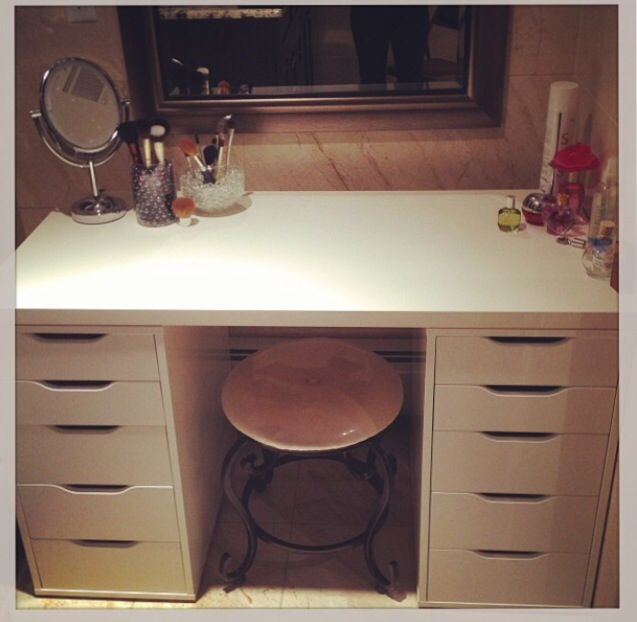 Ikea vanity: 2 ALEX drawer units ($80 each) and a LINNMON table top ($16). Chair and mirror from Homegoods. Super easy to clean makeup spills. Tons of drawers to store hair dryer, irons, brushes, makeup and nailpolish.