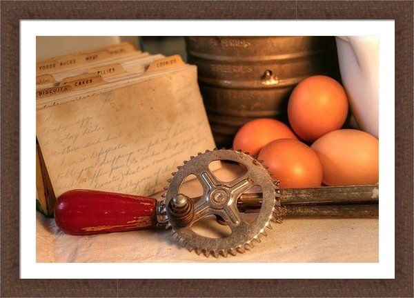 """Grandmas Kitchen Framed Print By Heather Allen, old school country farmhouse/cottage style décor complete with a vintage egg beater, eggs, sifter, milk glass bowl and hand written recipe card (my grandma's recipe in her writing for """"broken arm cookies"""", my great grampas favorite)"""