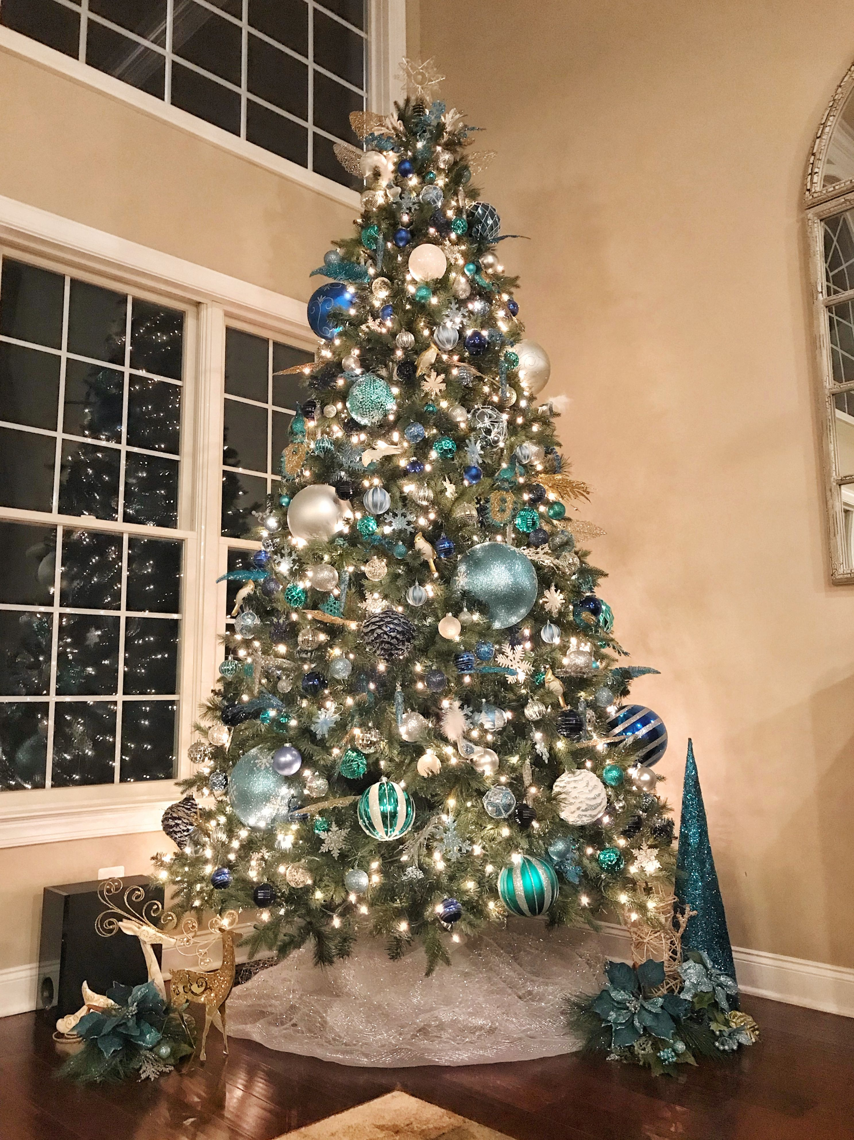 Tall Christmas Tree For Two Story Room Decorated In Blue Silver And Gold Blue Christmas Tree Decorations Glamorous Christmas Tree Elegant Christmas Trees