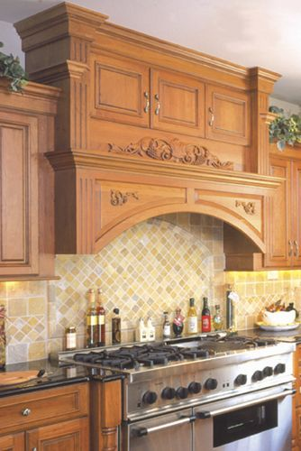 Wood Hood With Carved Onlays, Fluted Appearance Boards And Crown Moulding