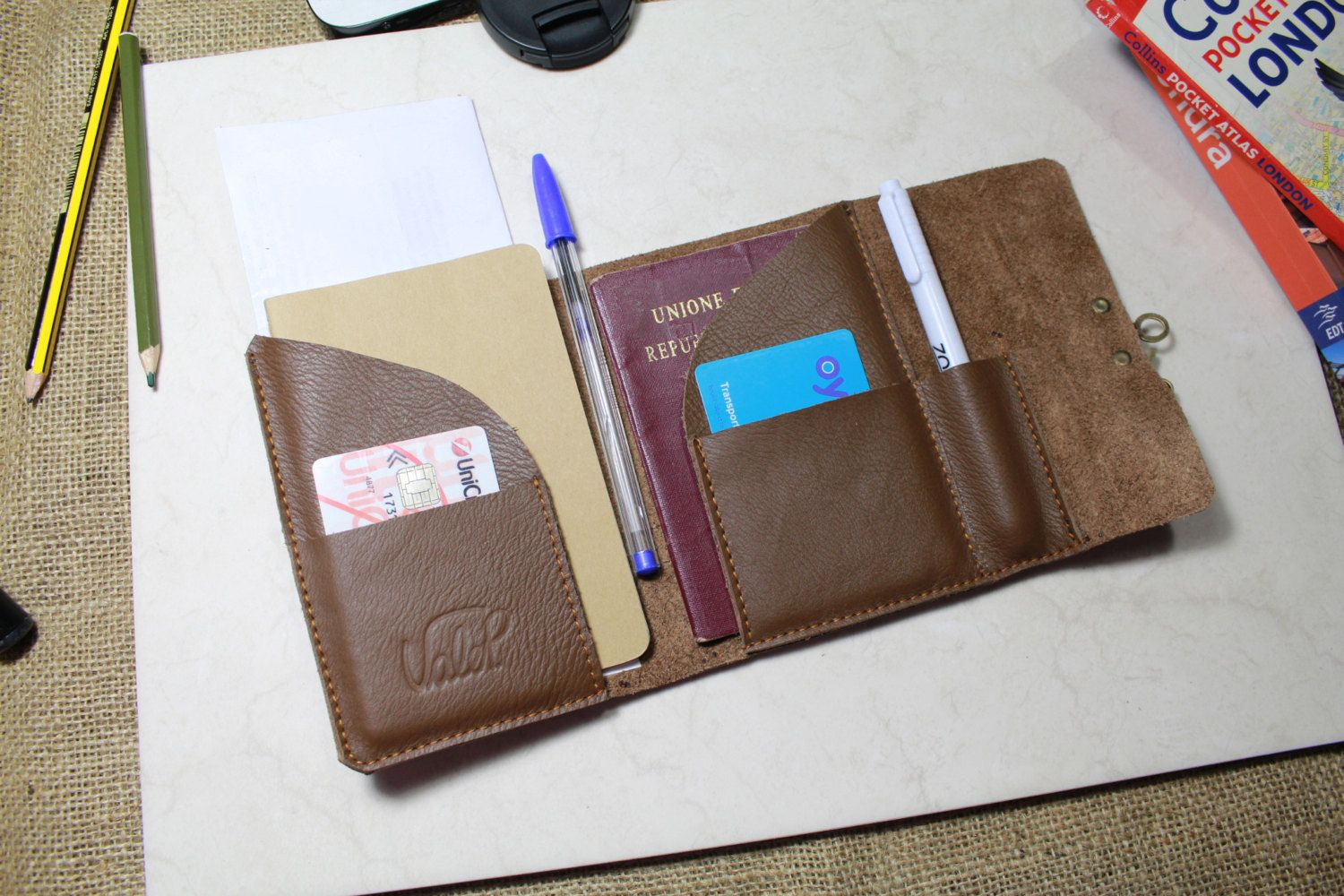 World map pouch with embroidered travel quote passport cover items similar to free shipping uk leather passport cover travel wallet passport holder passport case travel document holder handmade by valentina gumiabroncs Image collections