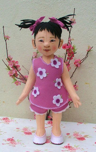 Helen Priem has many lovely dolls both human and animal. She has an DaWanda shop http://en.dawanda.com/shop/pips-poppies and also sells on ebay.