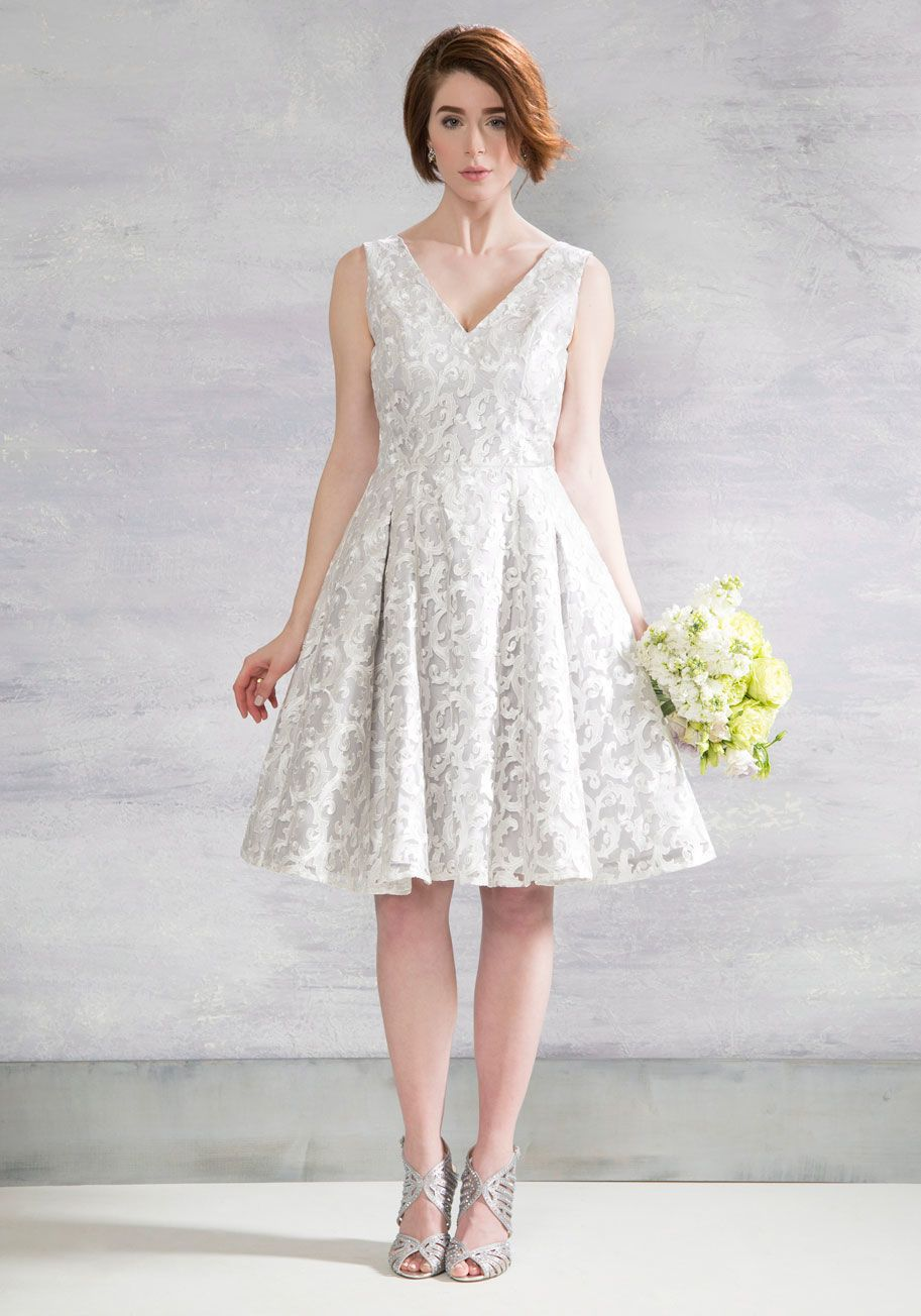 <p>The quickest ticket to an evening of whimsy and wonder is this fit and flare midi by Chi Chi London! Your route to ravishing is clearly paved by the swirling ivory embroidery and soft grey base tone of this elegantly pleated dress, so arriving at your cultivated destination is one fashionable affair.</p>