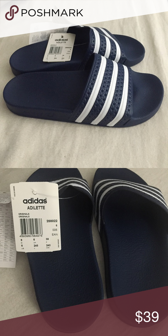 Brand new Adidas slides Brand new adidas slides . Very comfortable to walk  in  5b2dc3ec7