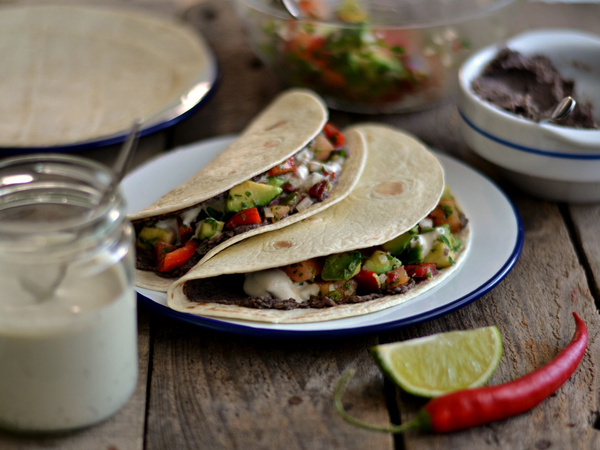 Black bean tacos with tomato avocado salsa and cashew sauce