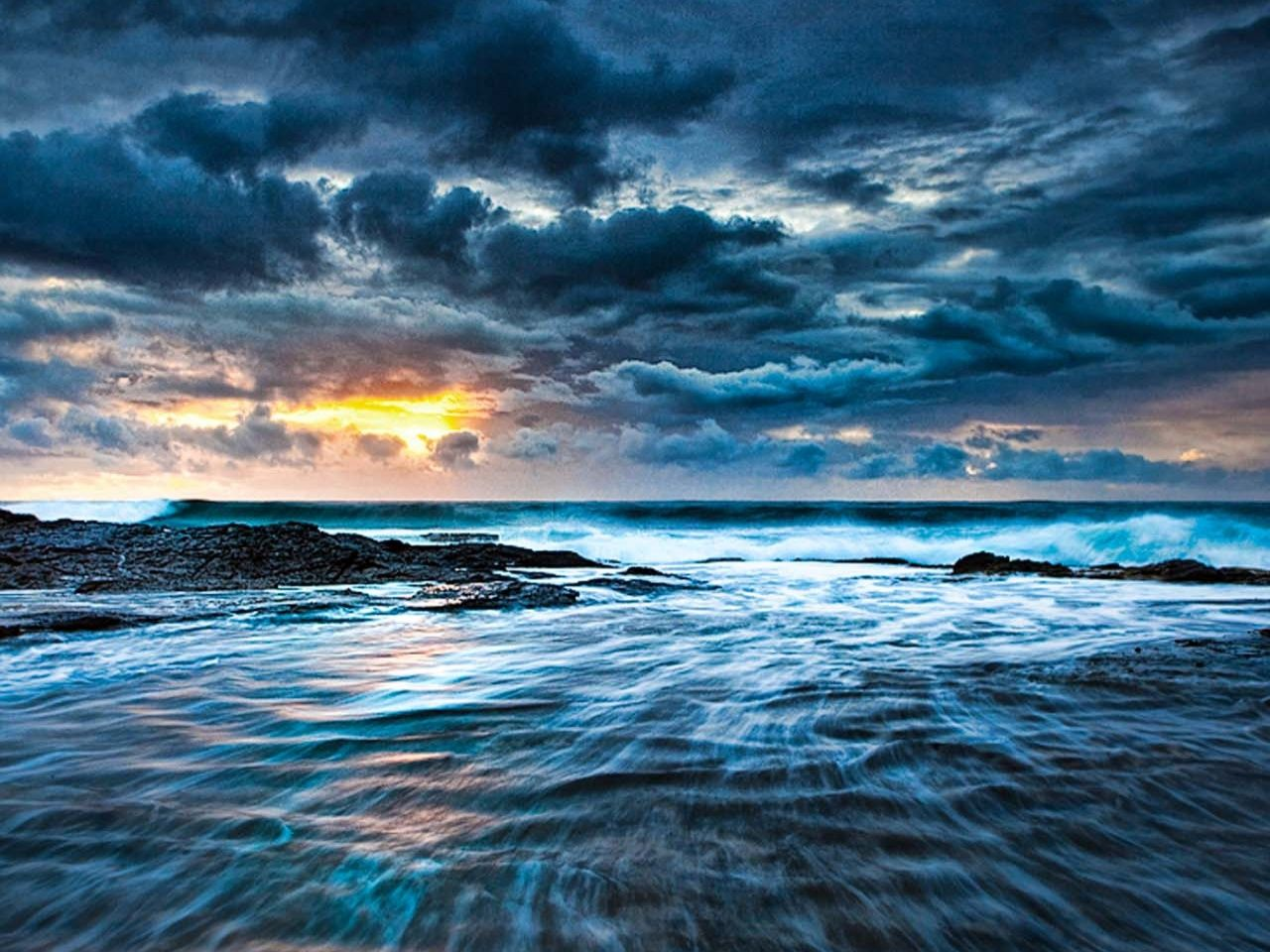 Stormy night sunset over the sea seascape tablet