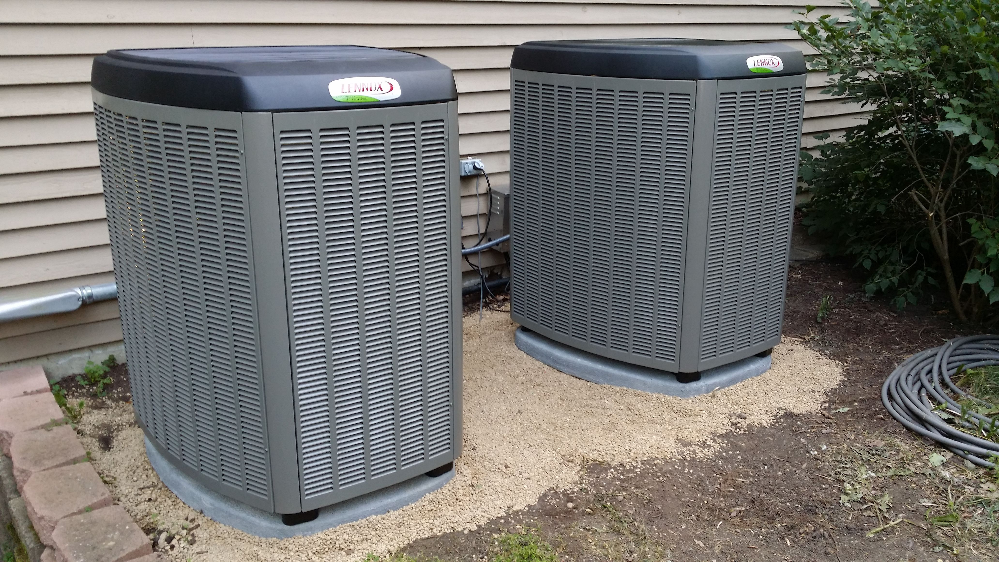 A Pair Of 25 Seer Variable Capacity Condensers Outdoor Portion