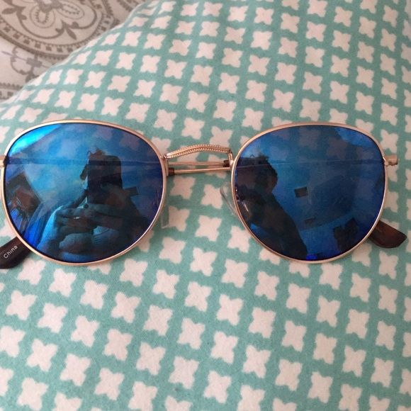 Brand new Francesca's Collection Sunnies! Brand new Francesca's Collection Sunglasses !  These are super cute and perfect for summer! Light weight gold frame with blue reflective lenses ! Francesca's Collections Accessories Sunglasses