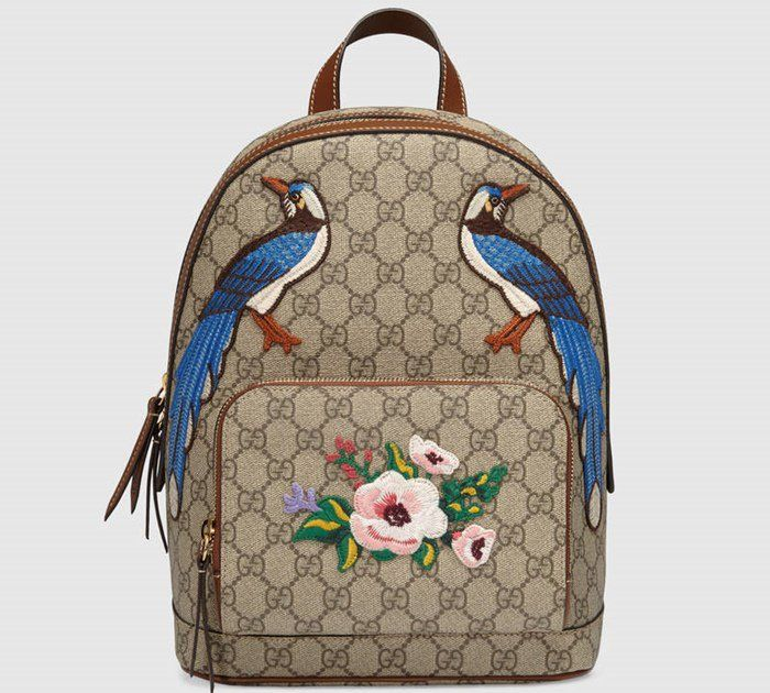 4d9387208c1c The Gucci Garden The Souvenir Collection Backpack is decorated with lovely  blue birds and a flower on its zip pocket.