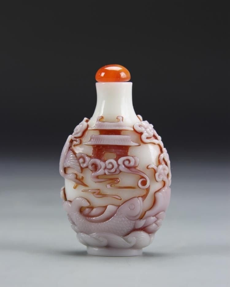 Chinese Peking Glass Snuff Bottle, 19th century. Carvings of fish and storks, embellished with burnt orange highlights - by Altair Auctions