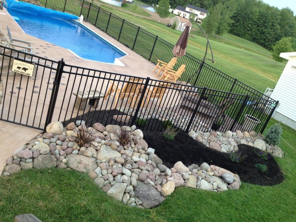 i 39 ve landscaped around our pool with rocks and a river of mulch that flows through the fence. Black Bedroom Furniture Sets. Home Design Ideas