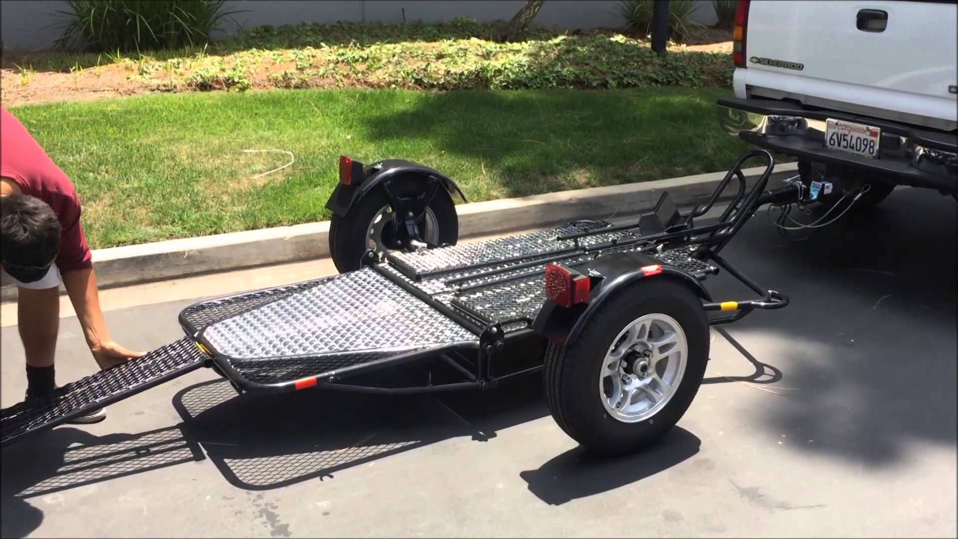 Single rail motorcycle trailer best motorcycle 2018 ultra tow single rail folding motorcycle trailer 700 lb load asfbconference2016 Choice Image