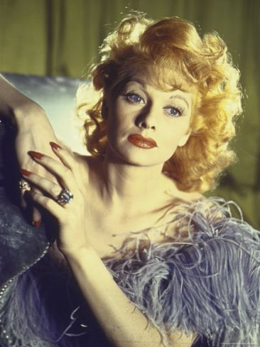 Portrait of Actress Lucille Ball Wearing Blue/Lavender Gown with Feathers