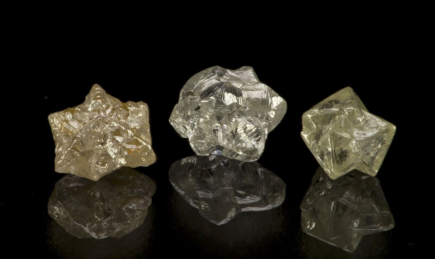 Rough diamonds with differing structure and color | Colored