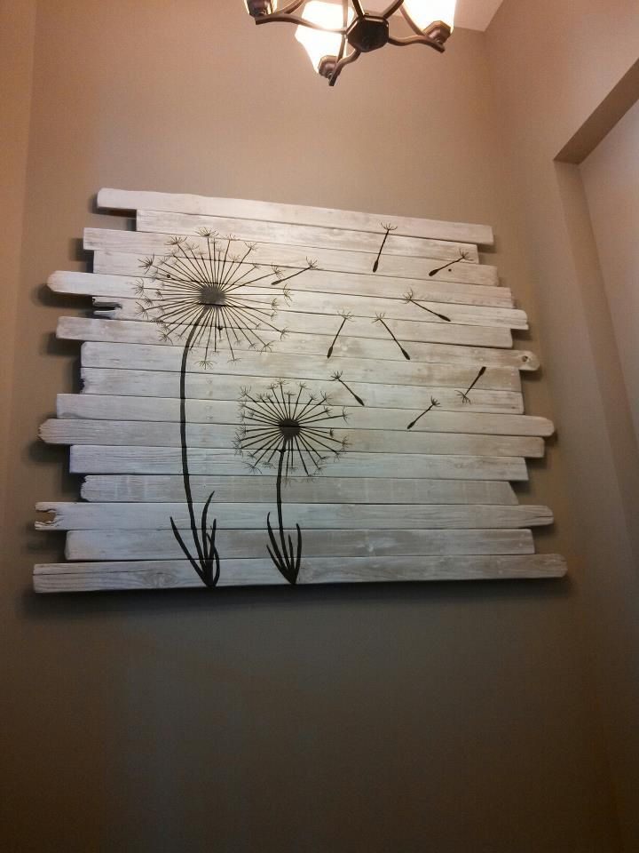 Pallet wall art with dandelions on whitewashed
