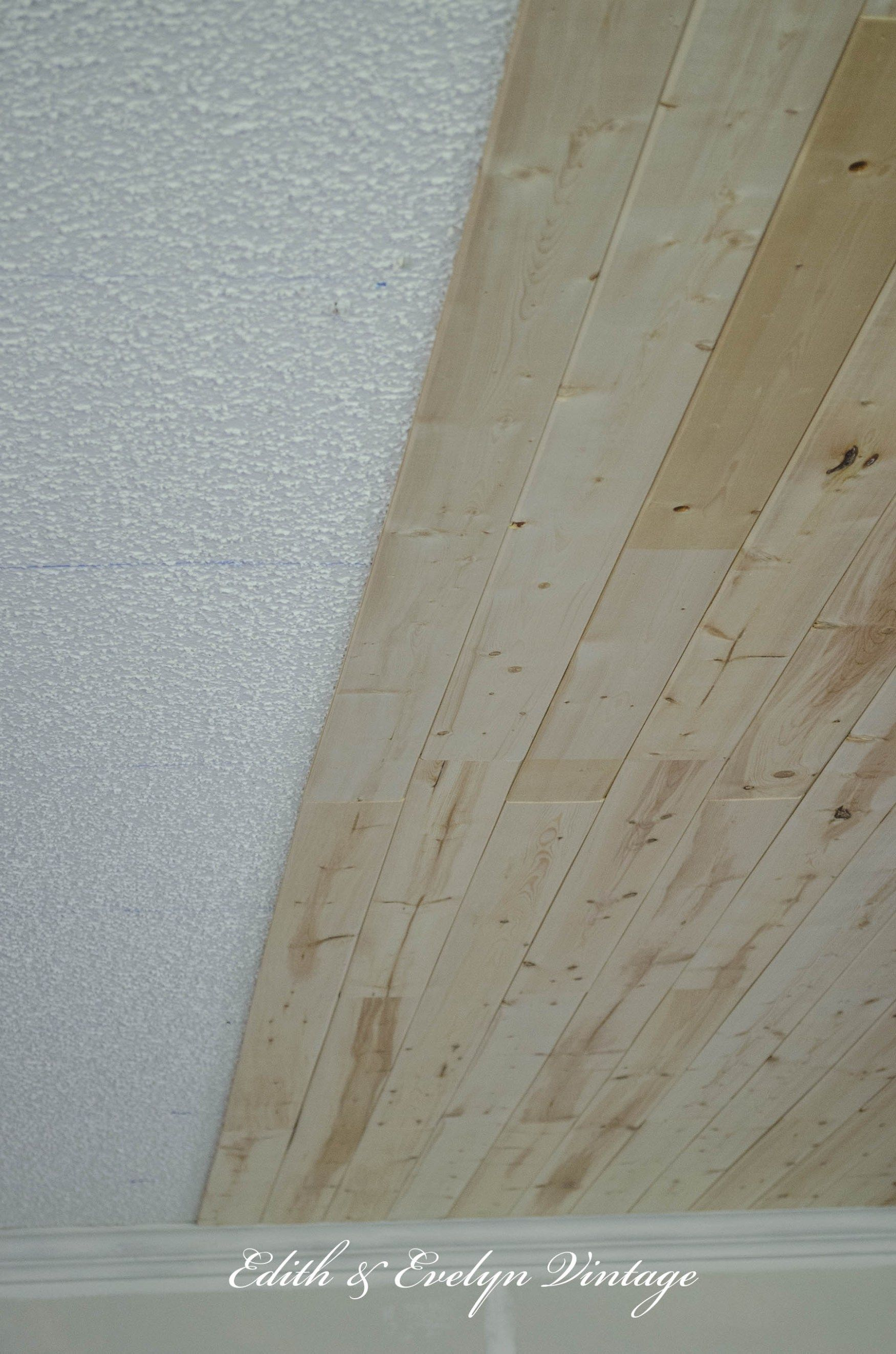plank a popcorn ceiling with lightweight tongue and groove wood planks