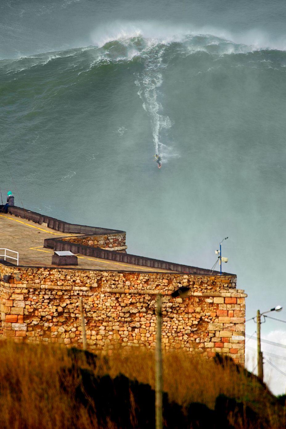 Garrett McNamara surfing a 100ft wave at Praia do Norte, Nazaré, Portugal