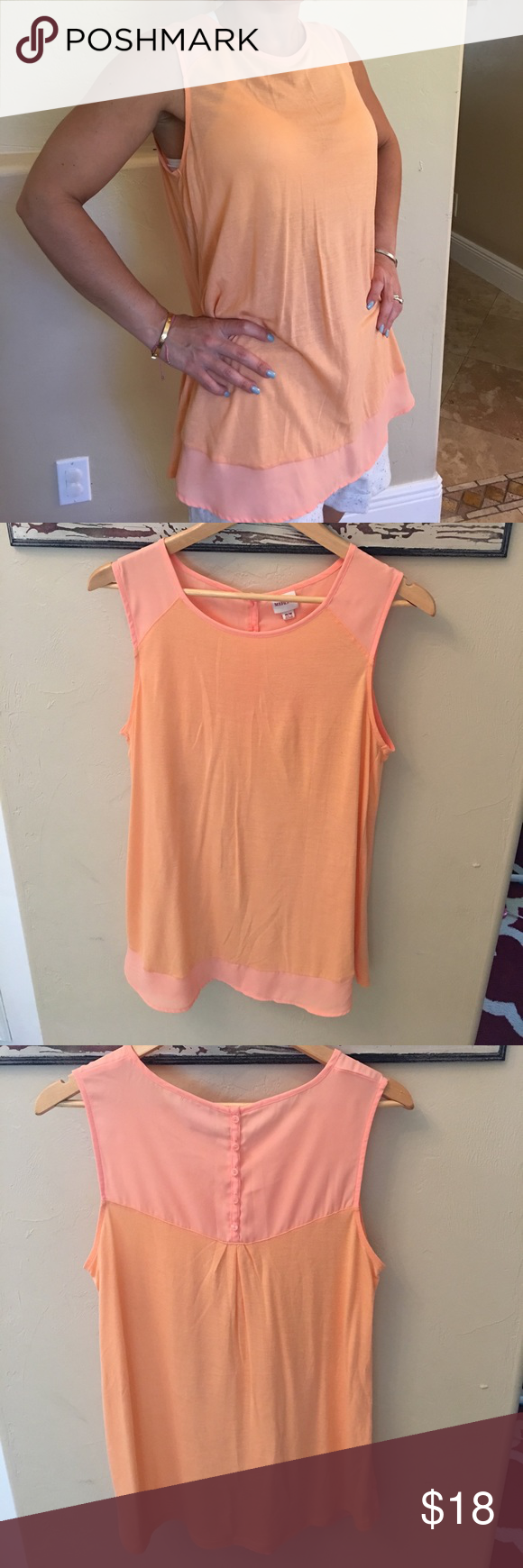 NWOT merona blouse Adorable never worn orange top. Nice button detail on the back Merona Tops Blouses