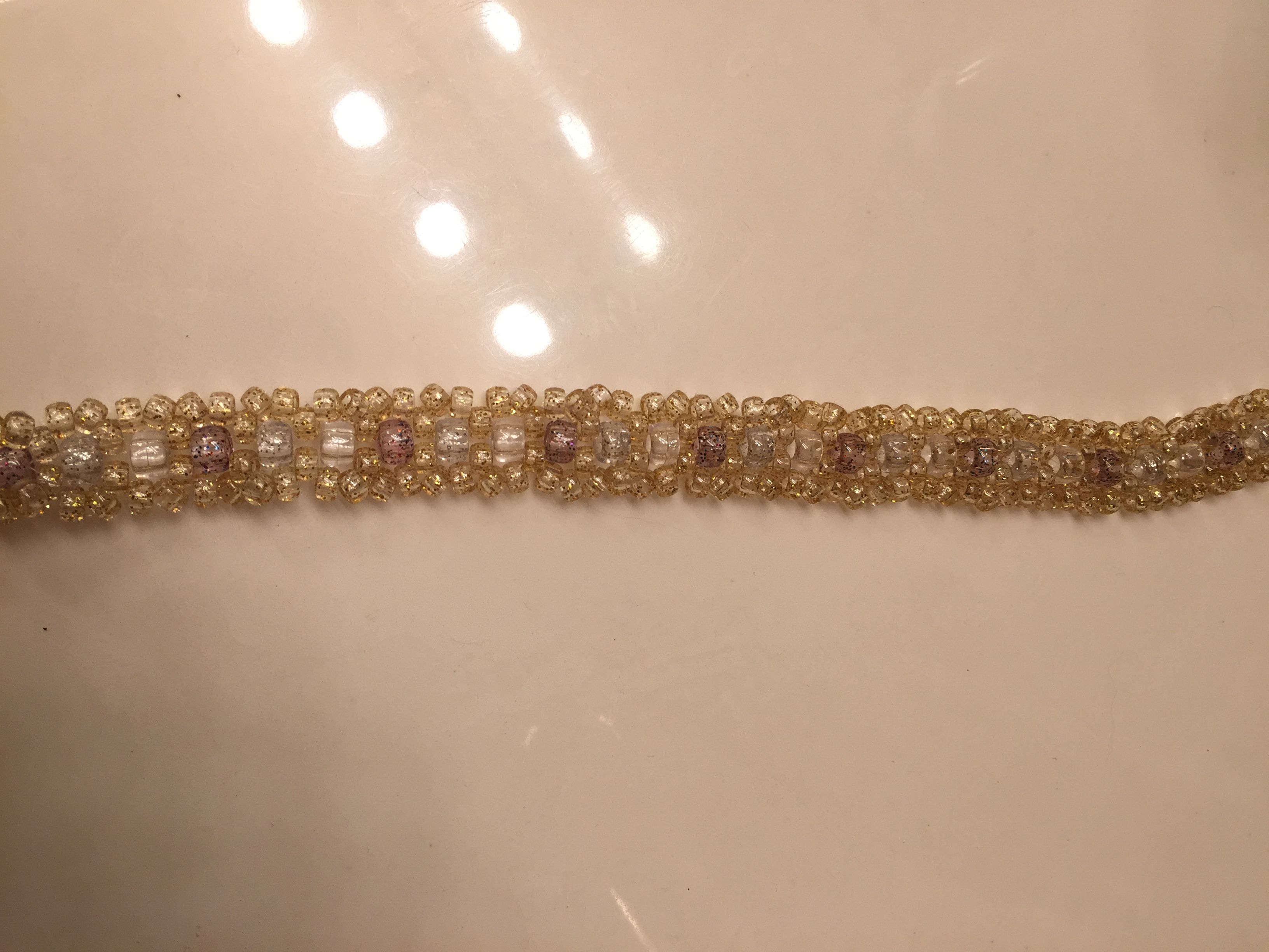 Banded with 9mm and mini pony beads.