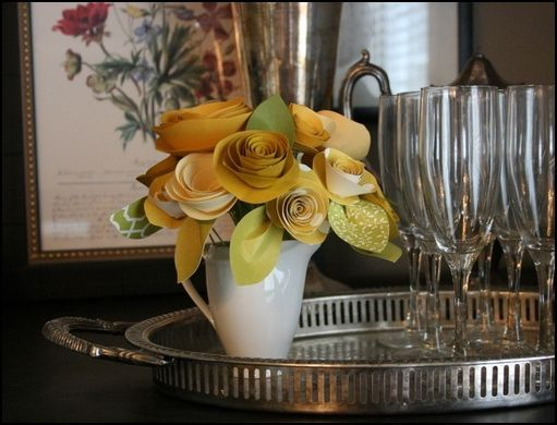 I like this as an alternative if we want the flowers to last a while and/or a florist is too expensive. Paper flowers!
