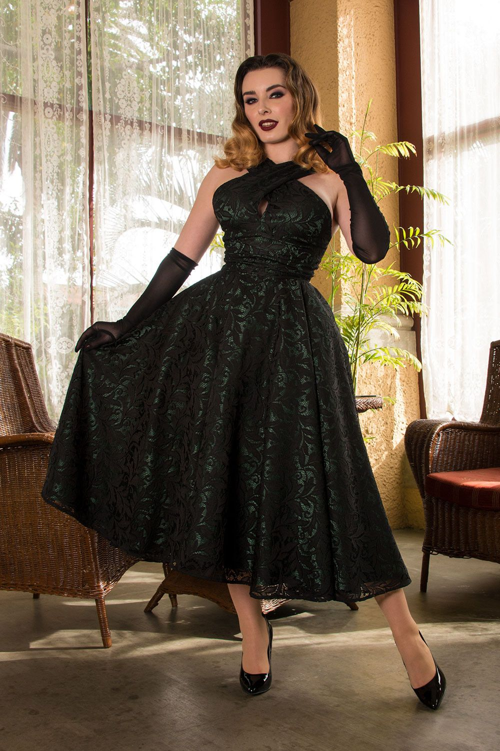 Green dress with lace overlay  Pinup Couture Mia Dress in Green Satin with Black Bisou Lace Overlay