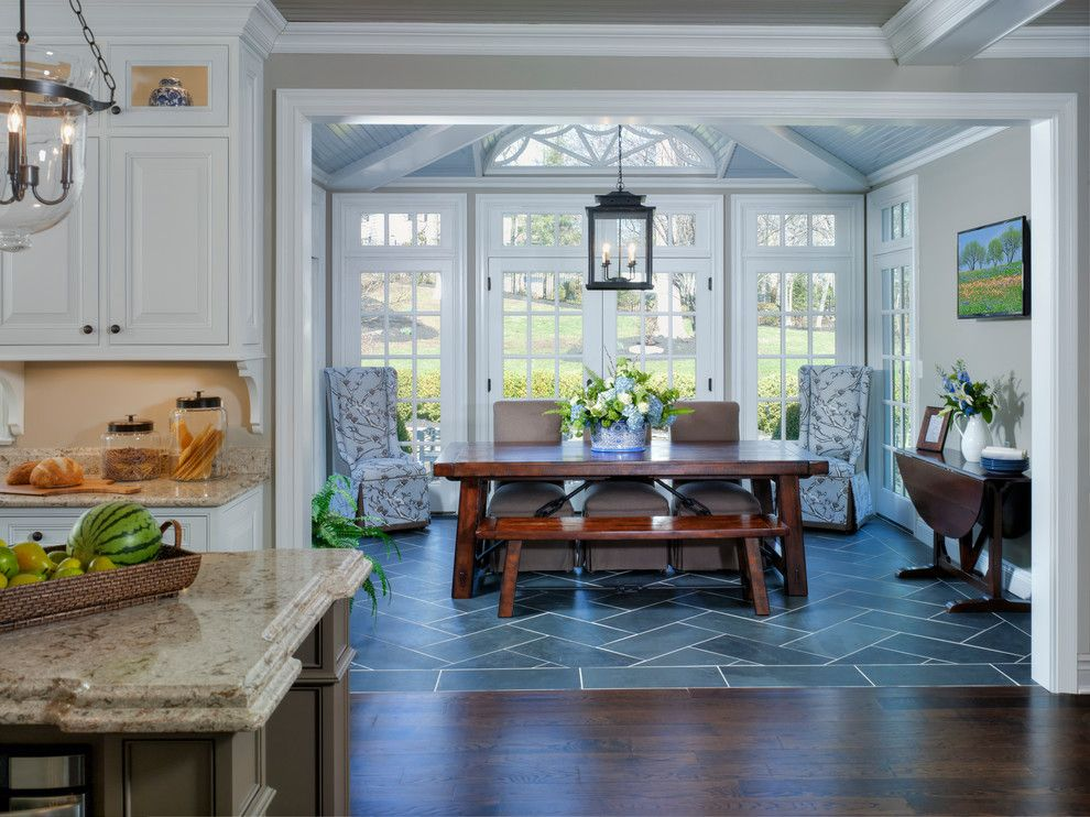 Wood Floor To Tile Transition Dining Room With Traditional Dark Table