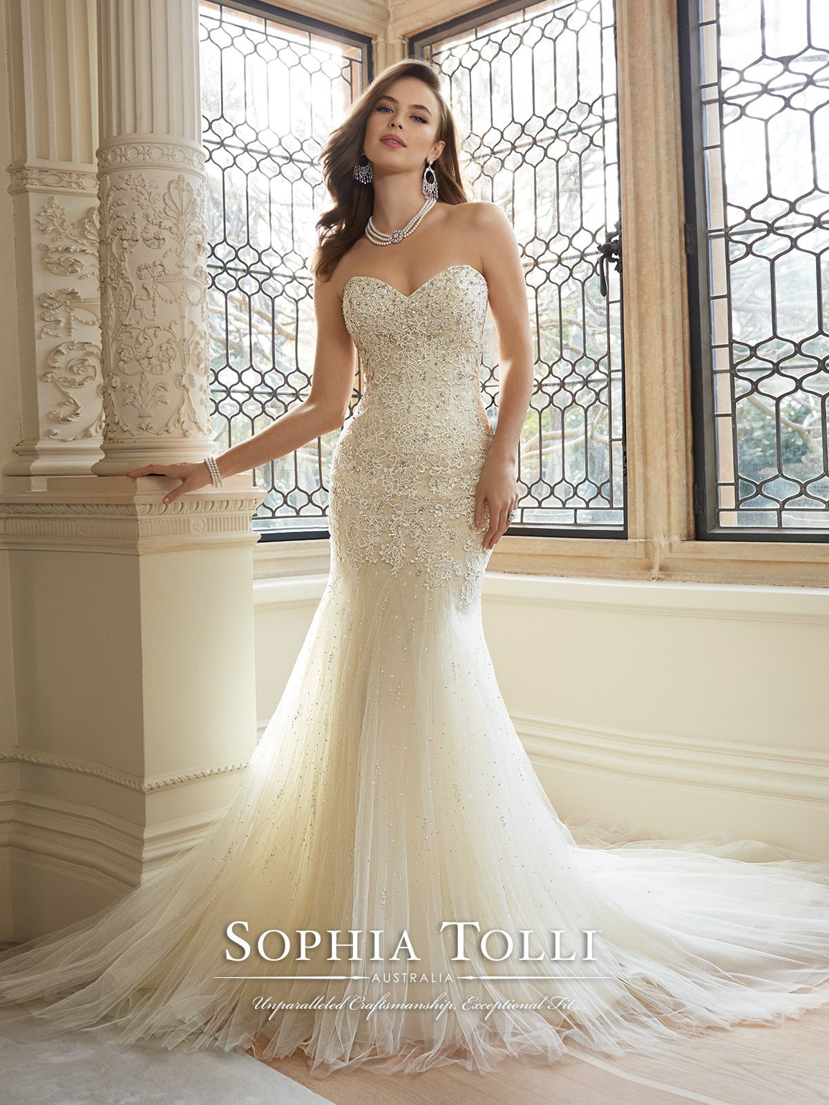 Sophia Tolli - Y11625 – Amira - Strapless sweetheart soft tulle fit and flare wedding gown with lace appliqué dropped waist bodice, sparkling crystal and cluster scattered beading decorate bodice and gathered tulle skirt, back corset, chapel length train. Removable spaghetti and halter straps included.  Sizes: 0 – 28  Colors: Magnolia/Ivory, Ivory, White