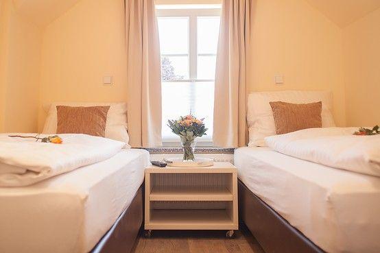 Das Schlafzimmer verfügt über zwei getrennte Boxspringetten