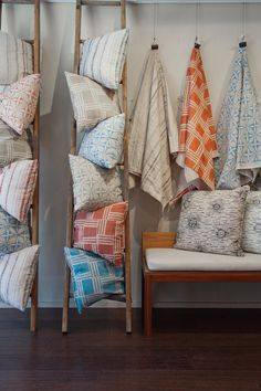 Visual merchandising. Retail store display. Home accessories. Pillows and throws displayed using rustic ladders.