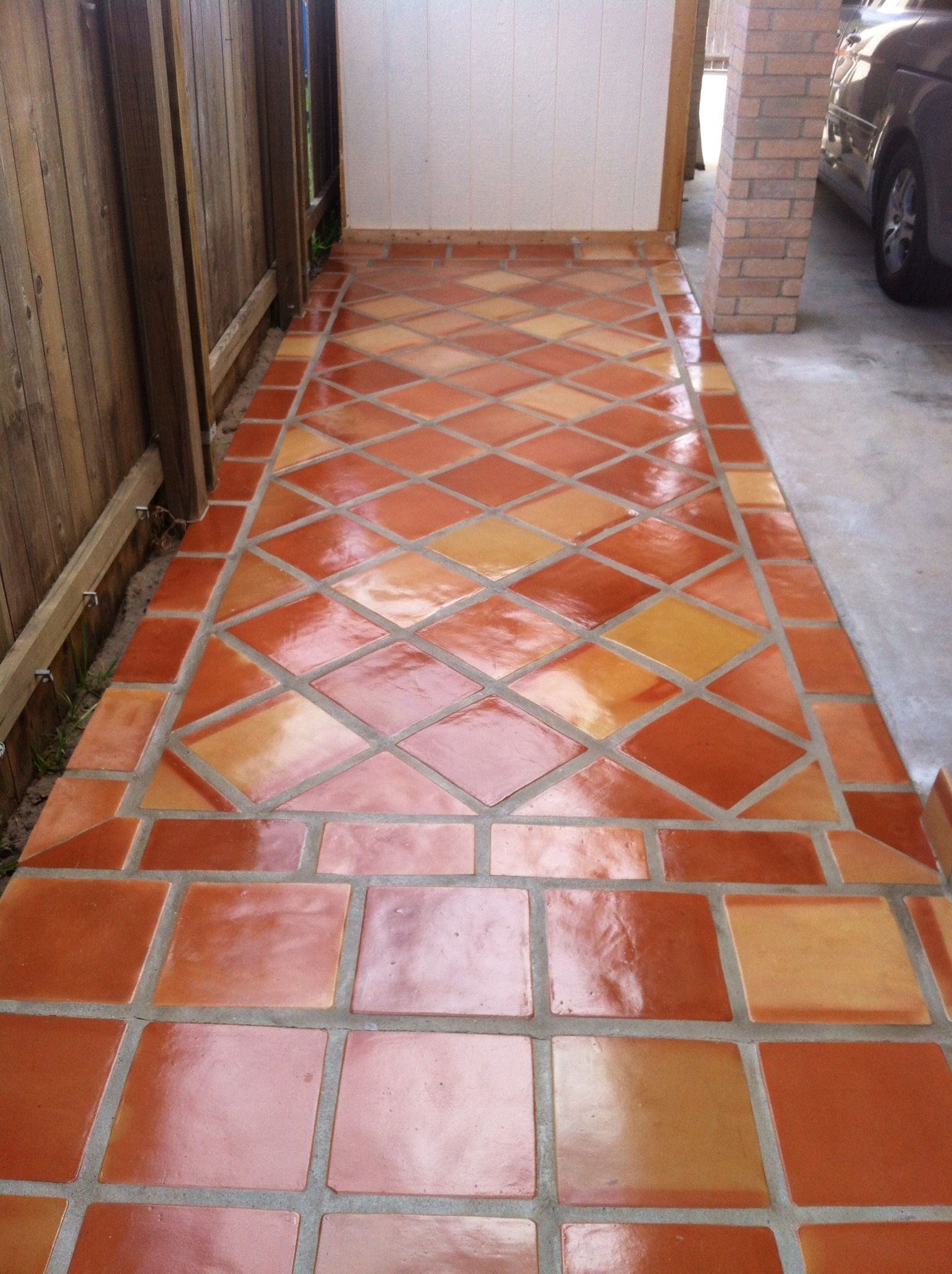 rustic terra cotta tile flooring with a high gloss finish. spanish