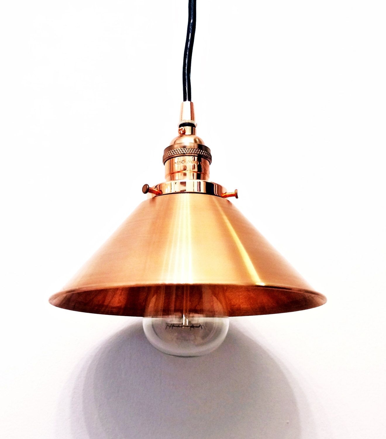 This is an industrial style pendant light made with a copper
