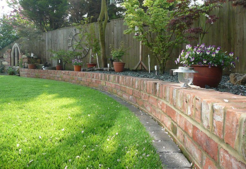 Garden Border Ideas traditional brick garden edging ideas 30 Brilliant Garden Edging Ideas You Can Do At Home