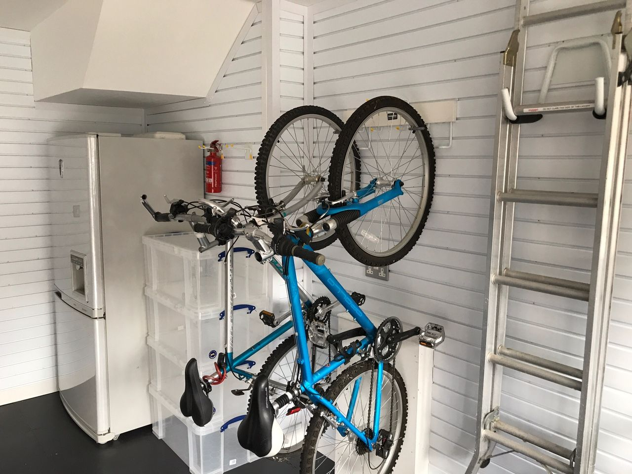Vertical Bike Rack Storage wall mounted on the garage wall