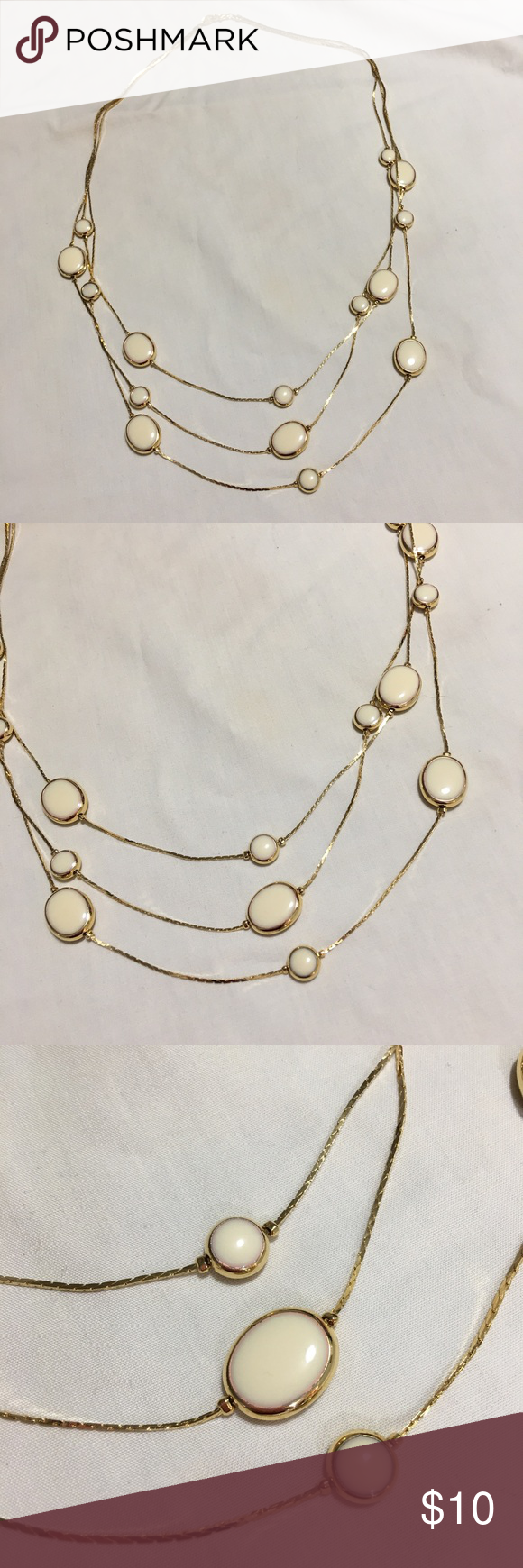 Selling this Vintage Avon Gold 3-Strand Ivory Disc Necklace on