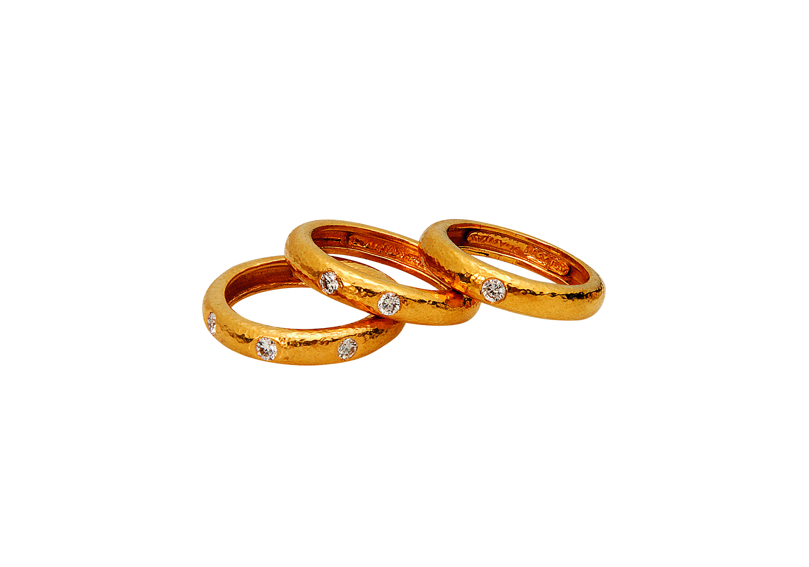 Rings in 22KT yellow hammered gold with diamonds from the Classics Collection. www.zolotas.gr