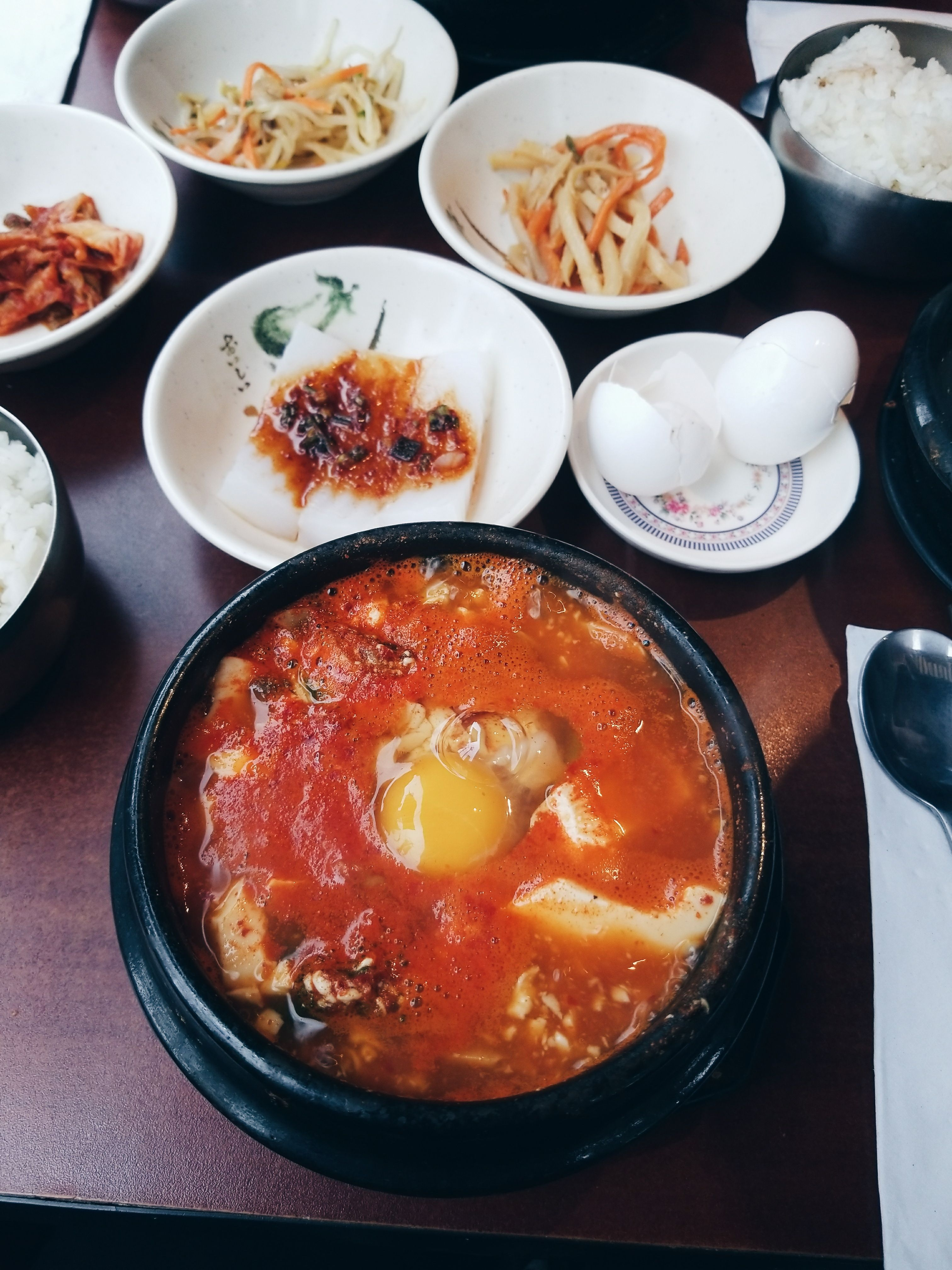 [I ate] Korean Tofu Stew (soondubu) - comes with a raw egg to crack directly in the bubbling hot bowl.