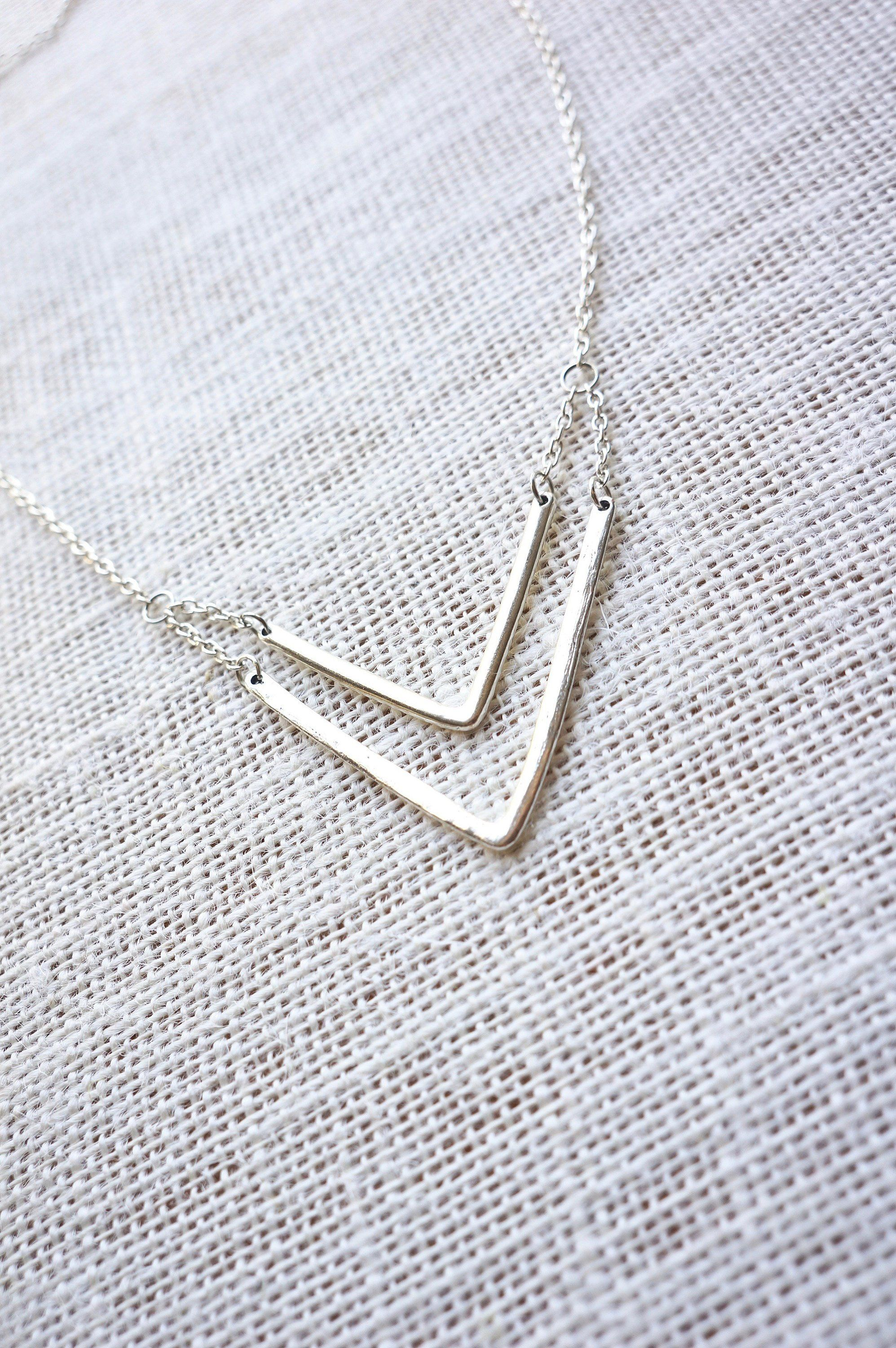 DOUBLE CHEVRON Necklace Silver, Teen Girl Gifts, V Necklace Silver, Boho Chic Jewelry, Simple Necklaces For Women, Layered Necklace Silver is part of Layered necklaces silver, Silver necklaces, Silver jewelry necklace, Silver necklace simple, Chevron necklace, Simple necklace - LilyDailyBoutiq OUR JEWELRY IS  Exclusively designed in Toronto  Artisan crafted and hand finished 💖Satisfaction Guaranteed💖 Lily Daily Boutique Timeless Pieces Effortless Beauty